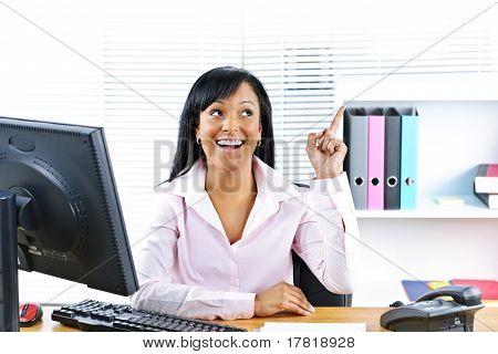 Businesswoman Having Idea At Desk