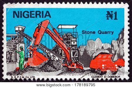 NIGERIA - CIRCA 1986: a stamp printed in Nigeria shows Stone Quarry circa 1986