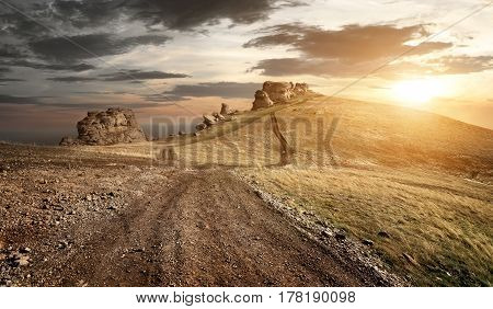 Evening over country road in high mountains