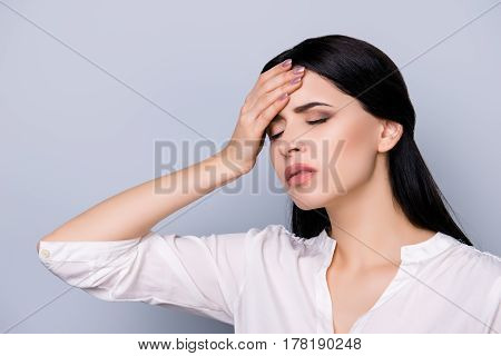 Exhausted Overworked Beautiful Young  Woman In Formalwear  With Black Hair  Touching Head, She Suffe
