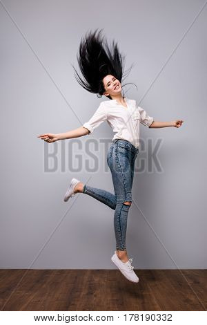 Successful Happy Pretty Woman Isolated On Grey Background Jumping Up