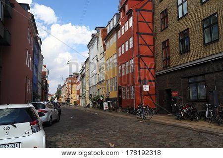 COPENHAGEN, DENMARK - JUNE 29, 2016: It is one of streets in historical part of district Christianshavn.