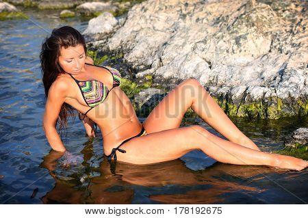 Young sexy girl in bikini on beach