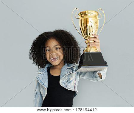Little Girl Holding Trophy Happy
