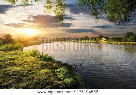 Beautiful sundown over the river in summer