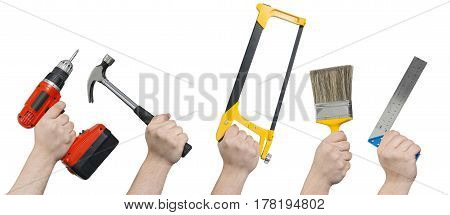 Screwdriver, Hammer, Hacksaw, Paintbrush, And Ruler In Hands Clipping Path
