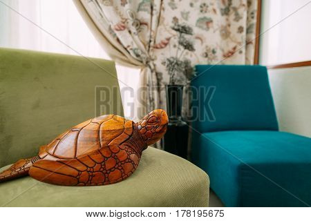 Wooden turtle. Elements of interior design apartments.