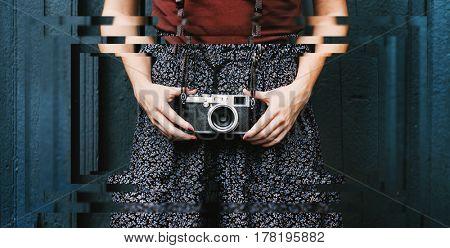Traveler photographer woman holding film camera
