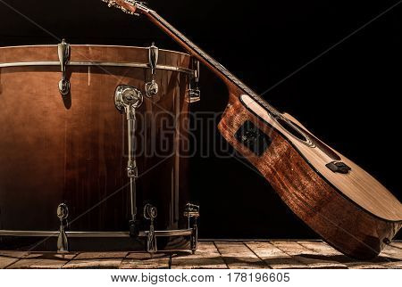 Musical Instruments, Drum Bass And Acoustic Guitar On A Black Background