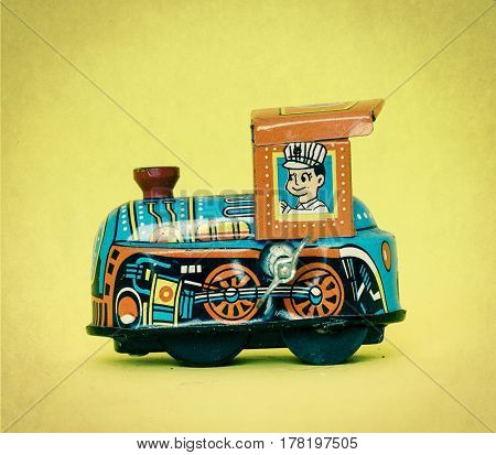 small toy train on a yellow background