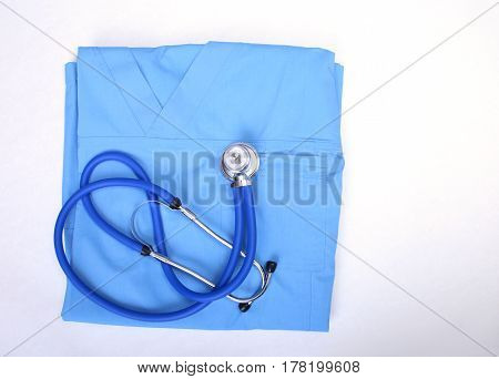 Medical stethoscope, Gloves, RX prescription on blue doctor uniform closeup. Medical tools and instruments shop, blood pressure measurement concept. you can place your text