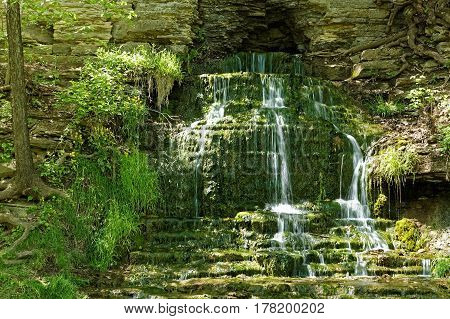 The water tumbles over the Beulah Spring Falls on May 15, 2016. This mossy waterfall has multiple levels as it cascades from the cliff face.
