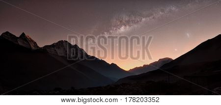 Sunset and the starry milky way overlooking a mountain range