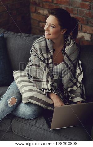 Lifestyle. Lovely woman on the sofa
