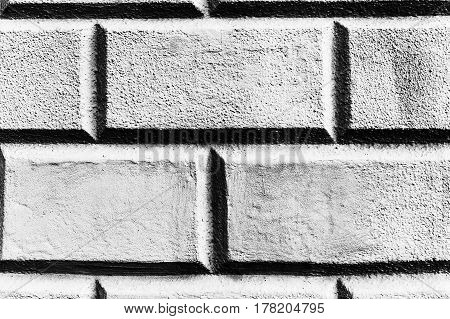 Abstract weathered texture stained old stucco light gray and aged paint white brick wall background in rural room, grungy rusty blocks of stonework technology color horizontal architecture wallpaper.