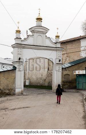 Man Enters The Church Arch.