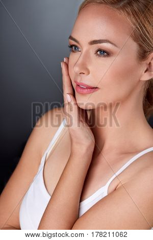 Woman enjoying in her perfect skin,  satisfied hers looks
