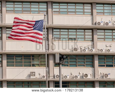 SEOUL South Korea March 18 2017:American flag flying on a flagpole in front of American Embassy in Seoul South Korea