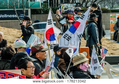 SEOUL South Korea March 182017: Protesters gather at a rally in central Seoul to demonstrate against the impeachment of Park Gun Hey