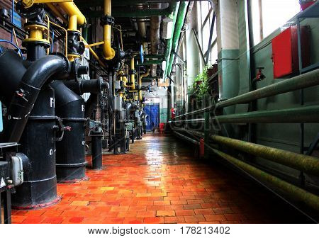 Pipes in a boiler room.  Water heating. Power supply.  Old boiler room