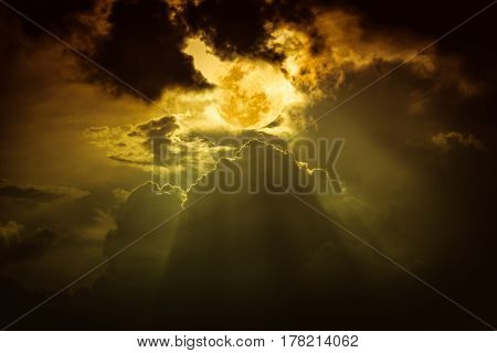 Attractive photo of night sky with cloudy and bright full moon over yellow nature background. The moon were NOT furnished by NASA.