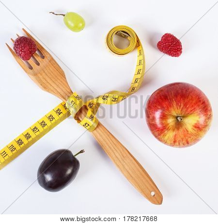 Fresh Ripe Fruits And Fork With Centimeter On White Background
