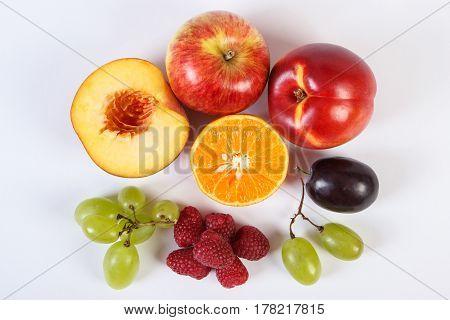 Fresh Ripe Fruits On White Background