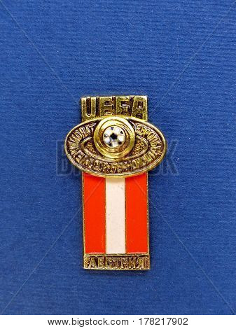 USSR - CIRCA 1984: Badge with the image ball and flag Austria, the inscription