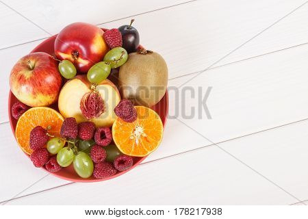 Fresh Ripe Fruits On Plate Lying On White Boards, Copy Space For Text