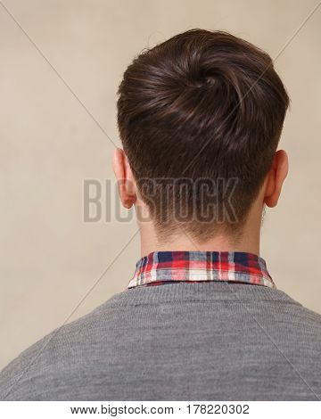 Men's fashion haircut. Beauty salon. Male beauty. The client is a hipster. An example of a hairdresser's work.