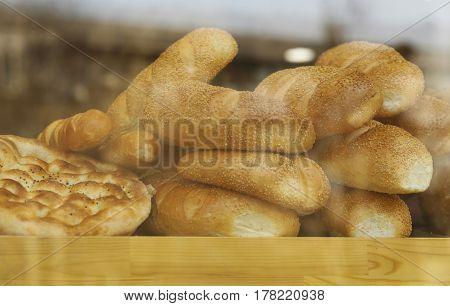 Assorted bread in shop window, low contrast