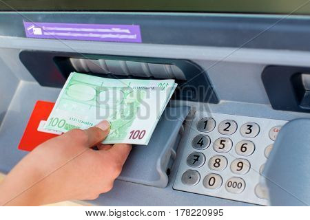 A bundle of money from one hundred euros. Women's hands hold money denominations of 100 euros. Cash out money at an ATM
