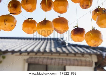 Sweet food made by hanging peeled astringent persimmon to become dried