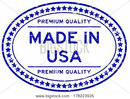 Grunge blue premium quality made in USA oval rubber seal stamp on white background