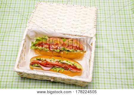 Ham sandwich and hot dog in a lunch box