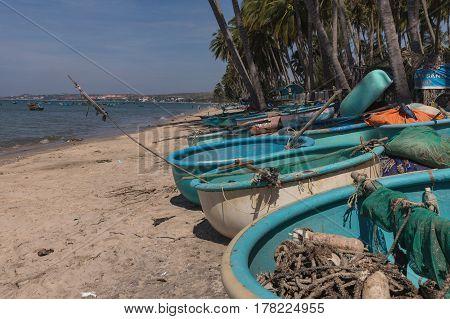 Mui Ne White Sandy Beach fishing boats on the beach Vietnam. Asia