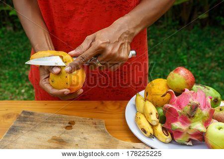 Asian Girl Peel Mango, Indonesia, Bali