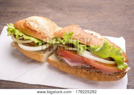 Ham with vegetables sandwich on a table napkin