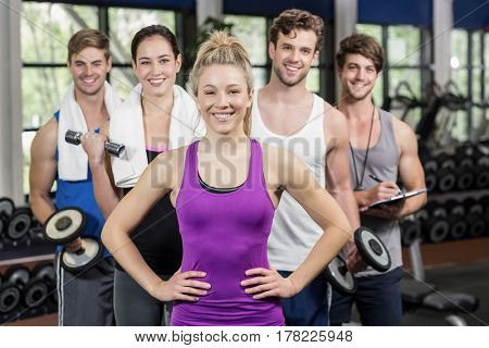 Fit people with sports equipment at gym