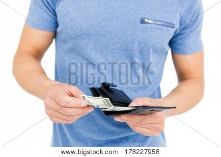 Close-up of young man removing money from his wallet on white background