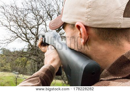 Close up of Young Man Hunting With Shotgun