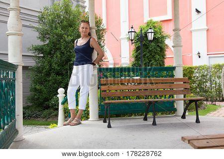 Portrait of attractive senior woman standing in pavilion.