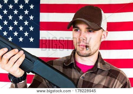 Young Man With Shotgun on American Flag Background