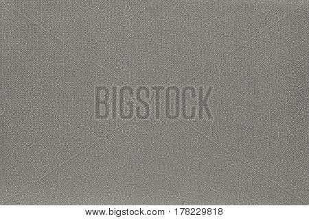 abstract speckled texture and background of textile material or fabric of pale color