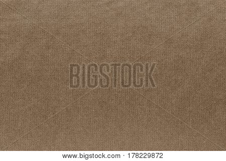 abstract background and speckled or mottled texture of fabric or textile material of khaki color