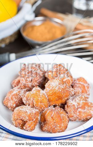 Homemade fritters with sugar and its ingredients