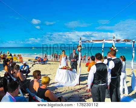 Punta Cana, Dominican republic - February 02, 2013: Groom and bride standing at beach at Punta Cana, Dominican republic