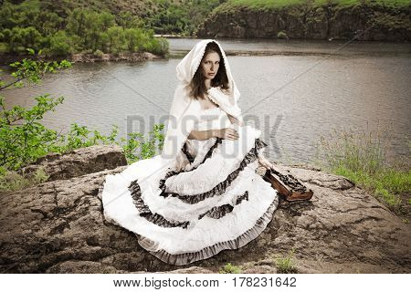 woman in cloak and long dress. outdoor shot