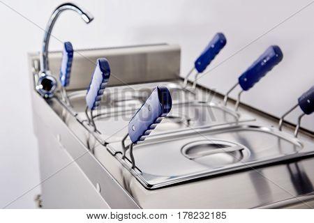 clean deep fryer close up photo in kitchen