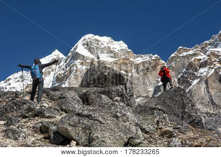 Photographer of high Altitude Mountain Expedition taking Picture of female Climber